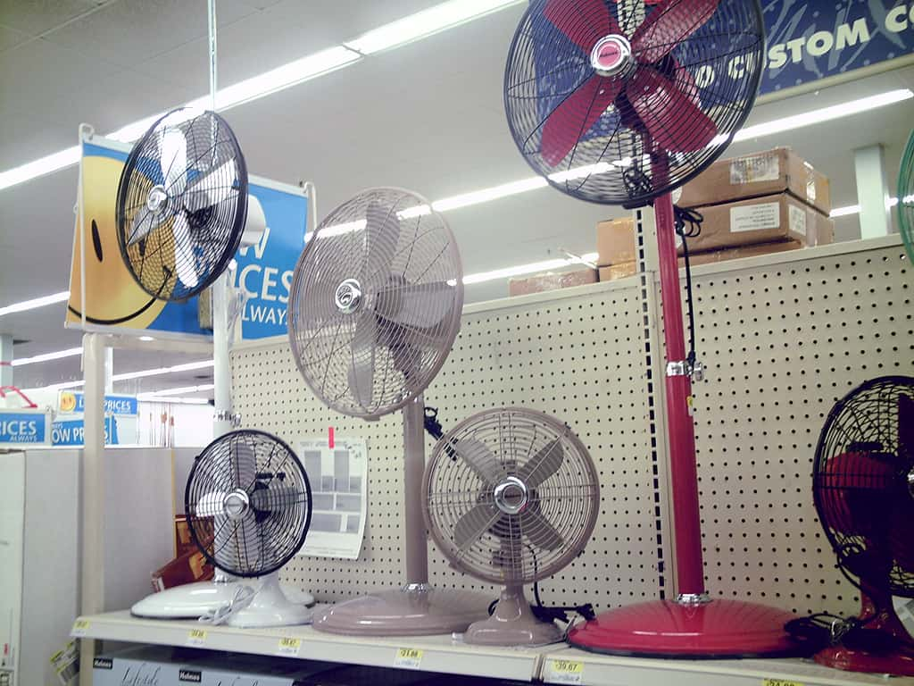 different sizes and colors of pedestal fans