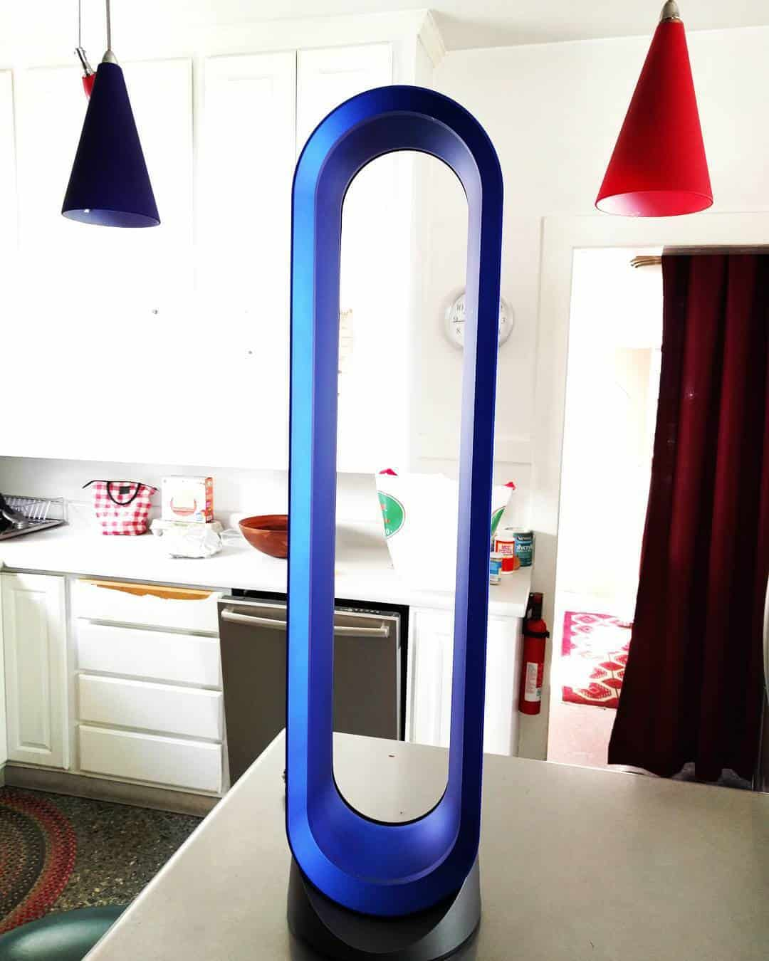 Blue Dyson fan in a living room #towerFan #fan #fans #whatfans #dyson #homeDecor #interiorDesign #livingRoom