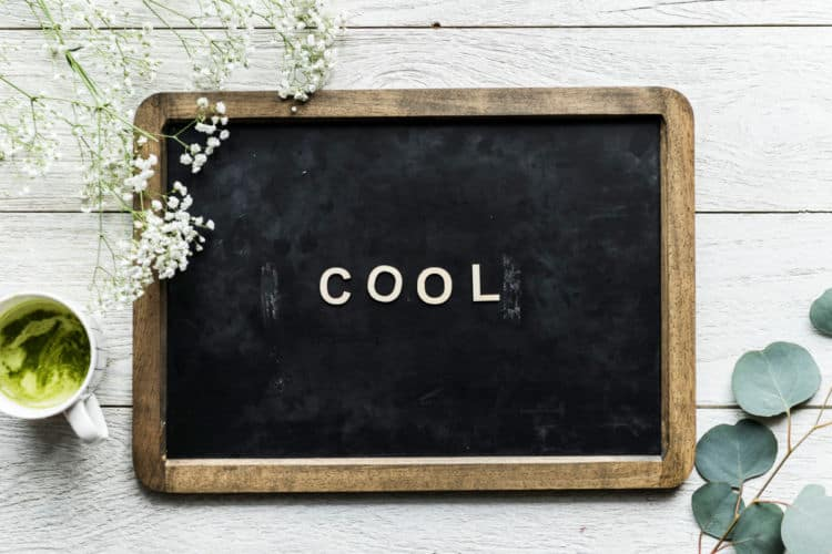 a chalk board with the word cool written on it